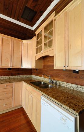 dark wood backsplash with granite countertop