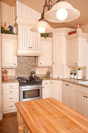 butcher block countertop with granite countertops