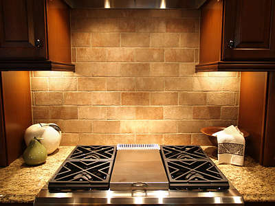 small stone subway tile backsplash