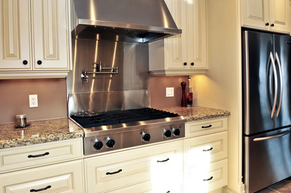 stainless steel backsplash over cooktop
