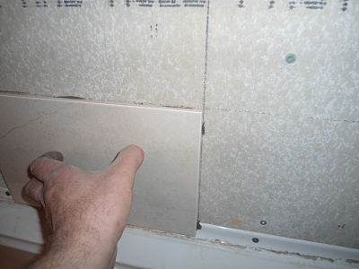 sticking ceramic tile to wall