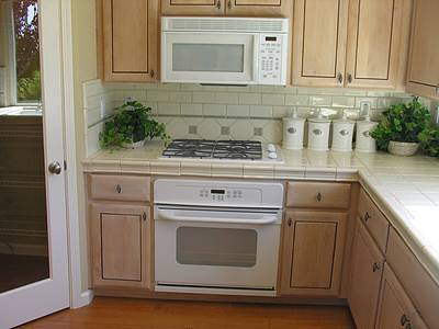 tan ceramic tile backsplash